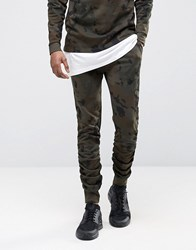 Asos Stacker Joggers With Camo Print In Khaki Camo Green