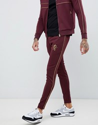 Gym King Skinny Joggers In Burgundy With Gold Side Stripes Red