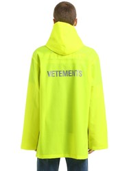 Vetements Logo Printed Rubberized Raincoat Yellow