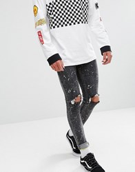 New Look Skinny Jeans With Rips And Paint Spray In Black Wash