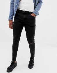 Bershka Super Skinny Jeans In Black Acid Wash With Knee Rips