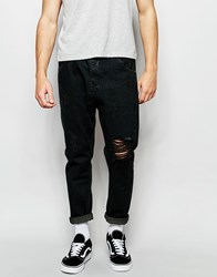 Asos Bow Leg Jeans In Washed Black With Raw Edge Waistband Detail Black