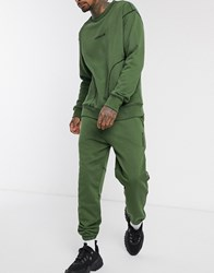 Mennace Slim Joggers With Contrast Stitching In Khaki Green