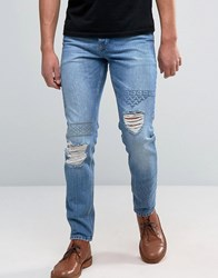Asos Slim Jeans With Embroidery And Rips In Mid Wash Mid Blue