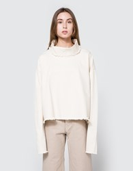Ashley Rowe Turtleneck In Cream