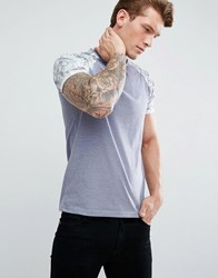 Solid T Shirt With Printed Raglan Sleeves Blue