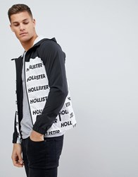 d8669726a4d95 Hollister Unlined Lightweight Hooded Jacket With Black And White Print Logo  Black Pattern