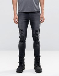 Asos Super Skinny With Mega Rips And Faux Leather Patch In Washed Black Washed Black