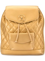 Chanel Vintage Circle Turn Lock Backpack Gold