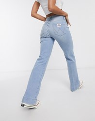 Wrangler Pocket Detail Flare Jean In Light Wash Blue