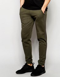 Asos Skinny Joggers With Stripe In Dark Khaki Forest Night Navy