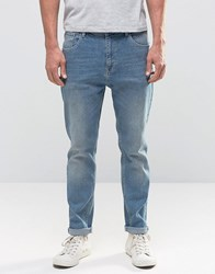 Asos Relaxed Tapered Jeans In Vintage Wash Mid Blue Mid Blue