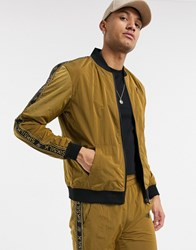 Sik Silk Siksilk Nylon Track Top In Gold With Logo Side Stripe