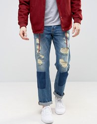 Asos Straight Jeans With Shadow Patching And Mega Rips In Mid Wash Mid Blue