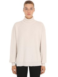 Nanushka Boxy Wool Blend Turtleneck Ivory