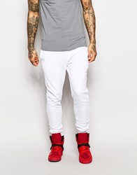 Criminal Damage Skinny Joggers With Distressing White