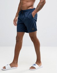 Asos Swim Shorts In Navy With Rubber Triangle Patch In Mid Length Navy