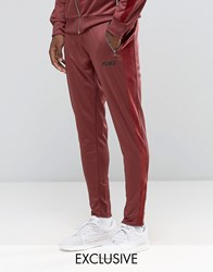 Puma Joggers With Velvet Trim In Tapered Fit Exclusive To Asos Red