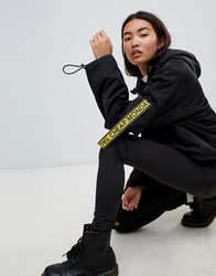 Cheap Monday Cropped Anorak With Multi Pockets And Logo Taping Black