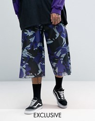 Reclaimed Vintage Inspired Wide Leg Cropped Trousers In Camo Nylon Purple