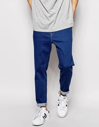 Asos Stretch Tapered Jeans In Bright Blue