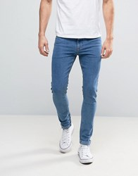 Asos Super Skinny Jeans In Retro Mid Wash Flat Mid Blue