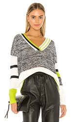 Central Park West Berlin V Neck Sweater In Black White. Lime Combo