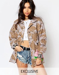 Reclaimed Vintage Oversized Military Jacket In Camo With Large Rose Embroiderey Blue