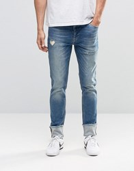 Asos Skinny Jeans With Turn Ups And Rips Mid Blue