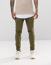 Asos Super Skinny Joggers With Knee Rips In Khaki Burnt Olive Green