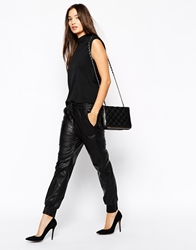 Sisley Trousers In Leather Look With Cuffs Black
