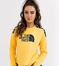 The North Face Tnl Long Sleeve Crop Top In Yellow