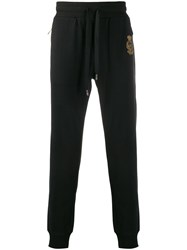 Dolce And Gabbana Heraldic Embroidered Motif Track Pants Black