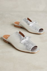 Anthropologie Intentionally Blank Silver Bow Mules