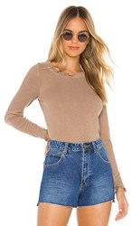 Chaser Ruffle Shirttail Open Neck Tee In Brown. Terra