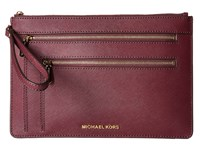 Michael Michael Kors Jet Set Travel Xl Triple Zip Clutch Plum Clutch Handbags Purple