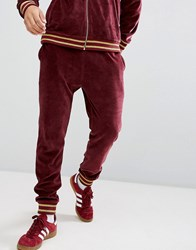 Asos Skinny Jogger In Burgundy Velour Red