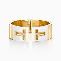 Tiffany And Co. T Cutout Hinged Cuff In 18K Gold With White Ceramic Medium. No Gemstone