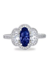 Platinum Plated Sterling Silver Simulated Diamond And Blue Lab Grown Sapphire Three Stone Ring