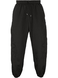 Nasir Mazhar 'Embroidered Technic' Cuffed Tapered Trousers Black