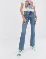Wrangler High Rise Flare Jean In Authentic Wash Blue