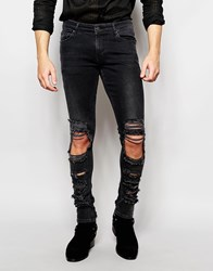 Asos Extreme Super Skinny Jeans With Extreme Rips In Washed Black Black