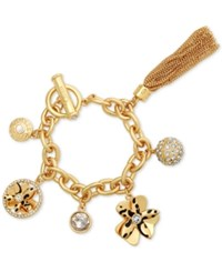 Guess Gold Tone Exotic Charm Bracelet