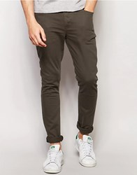 Asos Super Skinny Jeans In Dark Khaki Forest Knight Green