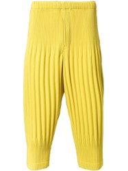 Homme Plisse Issey Miyake Pleated Cropped Trousers Yellow Orange