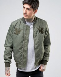 Asos Bomber Jacket With Eagle Embroidery In Washed Khaki Green