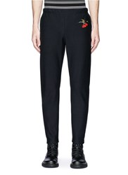 Alexander Mcqueen Hummingbird Embroidered Organic Cotton Sweatpants Black