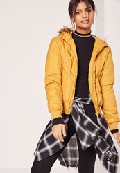 Missguided Faux Fur Hood Padded Bomber Jacket Yellow