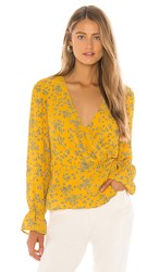 Cupcakes And Cashmere Joie Tossed Buds Wrap Blouse In Mustard. Harvest Gold