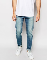 Asos Stretch Slim Jeans In Mid Wash Midblue